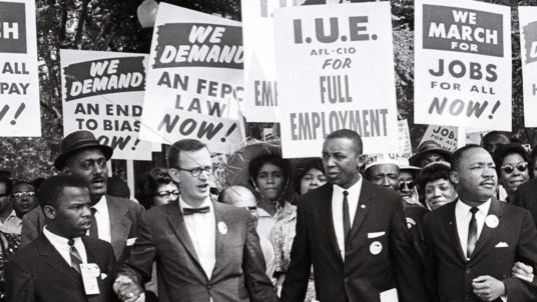 Mandatory Credit: Photo by Arnie Sachs/REX/Shutterstock (2920480c) John Lewis, Mathew Ahmann, Dr. Martin Luther King Jr, Rabbi Joachim Prinz, Whitney Young and other civil rights leaders hold hands as they lead a crowd of hundreds of thousands at the March on Washington for Jobs and Freedom Black Civil Rights Demonstration March in Washington DC, America - 28 Aug 1963 Reverend Dr. Martin Luther King Jr, 4th from left, and other civil rights leaders hold hands as they lead a crowd of hundreds of thousands at the March on Washington for Jobs and Freedom, Washington DC, August 28, 1963. from left to right: John Lewis, Mathew Ahmann, unidentified, Dr. King, unidentified, unidentified, Rabbi Joachim Prinz, unidentified, and Whitney Young.