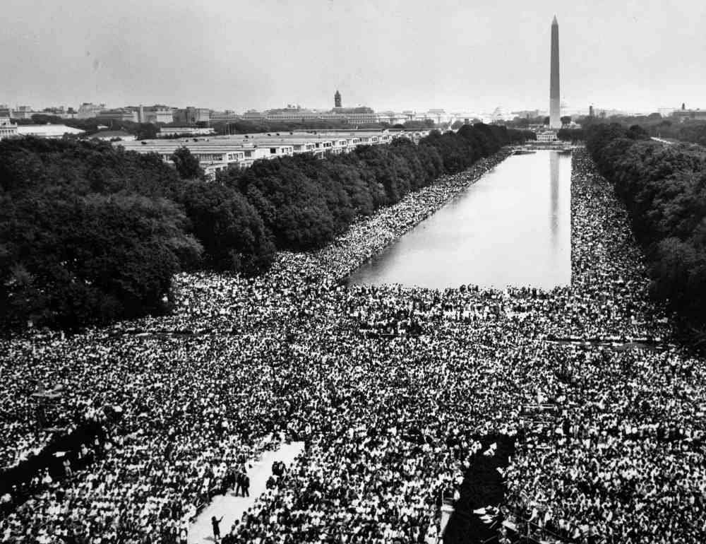 Hundreds of thousands of marchers gather around the reflecting pool during the 1963 March on Washington for Jobs and Freedom