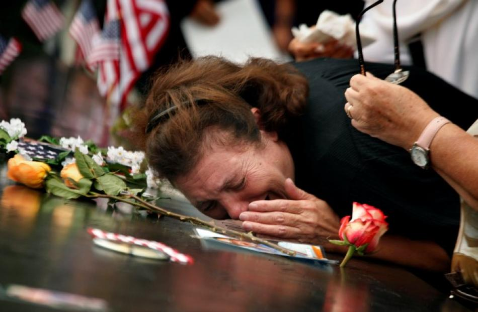 a_woman_mourns_her_son_who_was_killed_in_the_9_11__4e6d5a605f-3